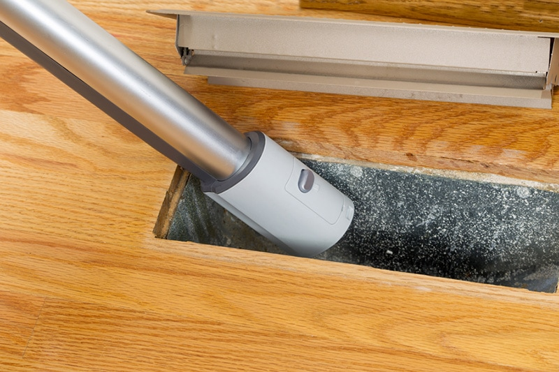 Vacuuming an air duct, Furnace Maintenance Tips
